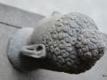 Patung Arca Kepala Budha Tampak Samping Atas